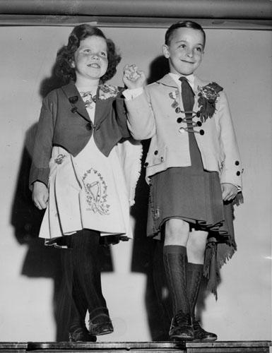 By 1957, boys are out of high heels and cut-aways and in kilts and